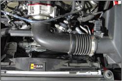 A 250-609 POWERAID Throttle Body Spacer installed on a 2016 Chevrolet Camaro 3.6L V6