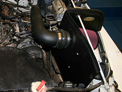 An AIRAID 312-176 Cold Air Dam Performance Intake System installed on a Jeep Wrangler YJ 2.5L