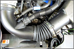 Stock intake tubes usually include a variety of noise-canceling baffles and corrugated sections