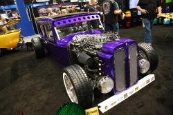 1929 Ford Sedan in House of Kolor booth with AIRAID filter at 2016 SEMA show