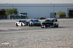 View of Randy Johnson on road course with two other cars.