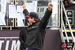 Photo pf Ken Thwaits with hands in air after learning about his win!