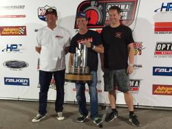 Photo of Ken Thwaits, 2nd place, Danny Popp, 1st Place and Rich Wilhoff, 3rd place on the podium