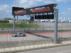 Shot of Jordan Priestley on the COTA Road Course just under the banner