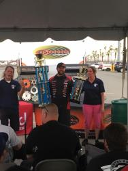 Shot of Jordan Priestley accepting his trophy as Grand Champion NMCA West Hotchkis Cup Series