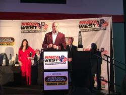 Shot of John Hotchkis at the NMCA WEST Awards Ceremony speaking to the audience