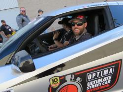 Picture of Jordan driving out of the Optima Alley heading to SEMA Ignited
