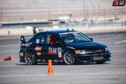 Photo of Thwaits and his 2006 EVO on the Detroit & Engineering Autocross