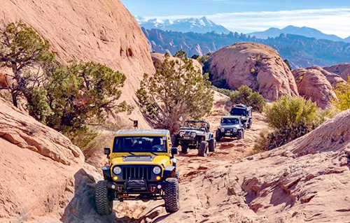 Jeeps traversing a trail at Jeep Jamboree