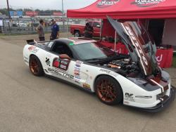 View of the '02 Corvette DZ06 of Randy Johnson in pits at Wilwood Disc Brakes tent