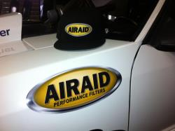 Photo of Larry Geddes driver side front fender with AIRAID decal and new Team Driver hat design