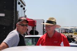 Photo of Larry Geddes with fellow competitor in the pits