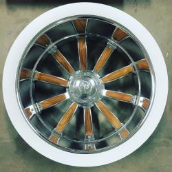 Teak wood inserts garnish the Plymouth Rock's custom-made wheels.