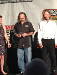 Shot of Marc Lewis receiving his award as Compact Class Champion
