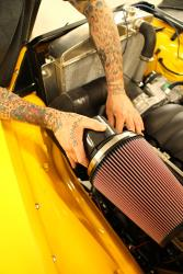 Photo of Jason installing the AIRAID U-Build-It Universal Air Intake System