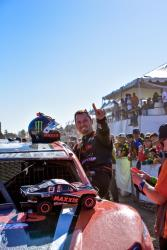 AIRAID-sponsored driver Jeremy McGrath showing off his clean truck after winning